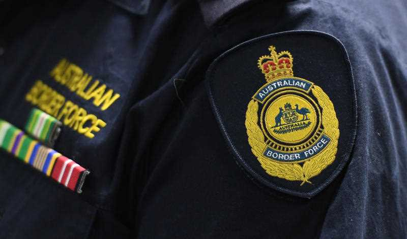 An Australian Border Force emblem is seen on a uniform during a press conference at the Australian Federal Police headquarters.