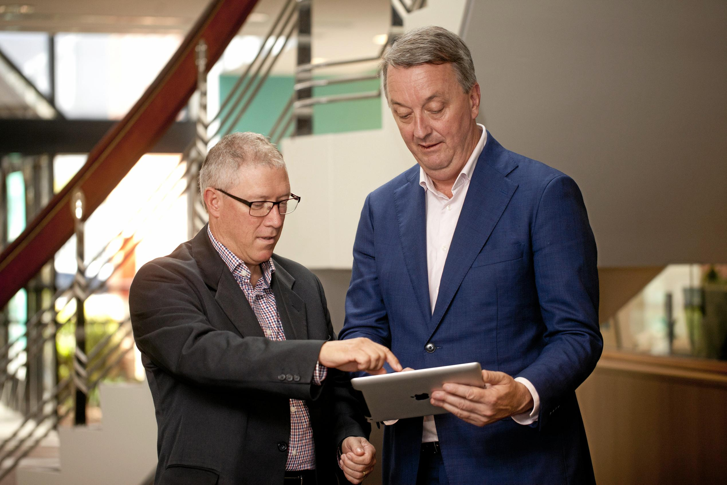 DEMENTIA LIVING: Norm Smith, a carer, demonstrating The Dementia-Friendly Home app with Martin Foley MP, Victorian Minister for Housing, Disability and Ageing.