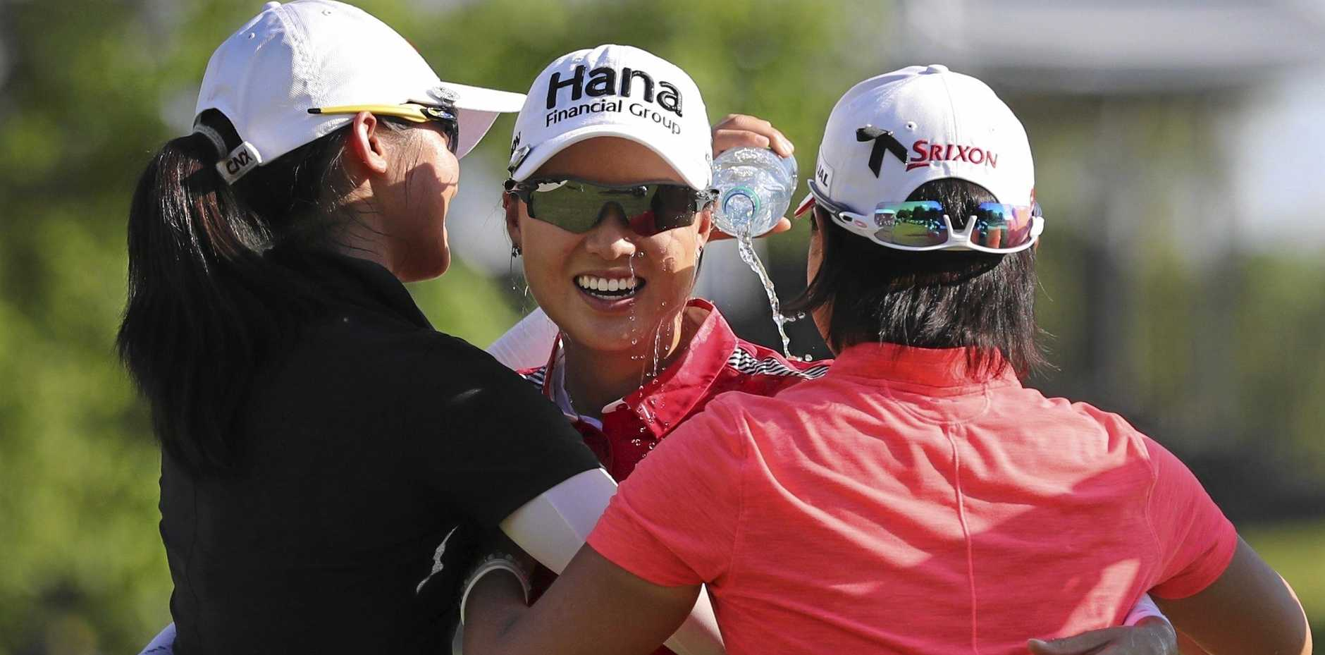 SPLASH FOR CASH: Australian golfer Minjee Lee, centre, is doused with water after winning the LPGA Volvik Championship on the final hole at the Travis Pointe Country Club, in Michigan.