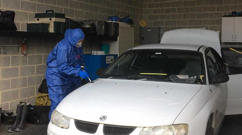 Police have been forensically examining a white Holden Commodore that could have links to a Ballina murder.
