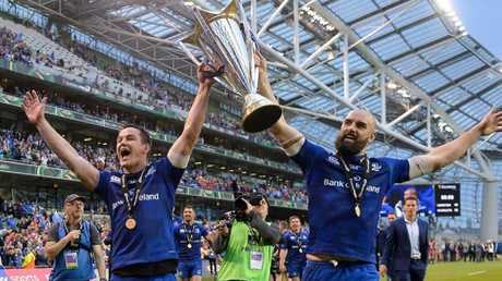 Former Wallaby Scott Fardy lifts the Pro14 trophy with Irish fly-half Johnny Sexton after Leinster defeated Scarlets at the Aviva Stadium.