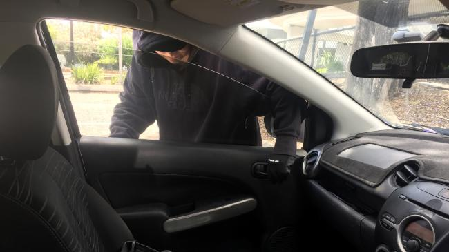 The man's shoes, jumper, cap and mobile phone were taken from the front seat of his car during the alleged robbery. Generic image.