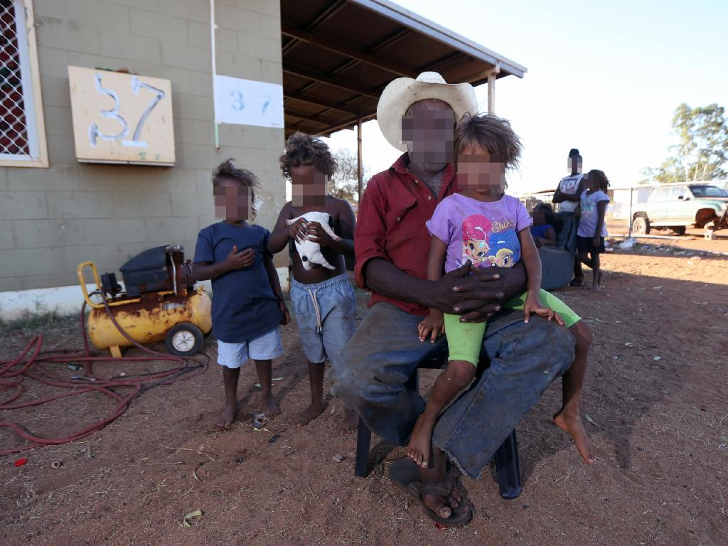 Dudley Hines with grandchildren at Nturiya community. Mr Hines refuses to let anyone who has been drinking come anywhere near his family. Picture: Gary Ramage/News Corp Australia