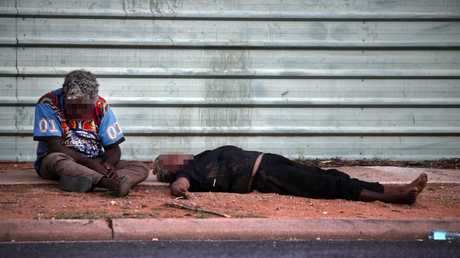 A woman lies drunk on the streets of Alice Springs, in the midafternoon. Picture: Gary Ramage/News Corp Australia