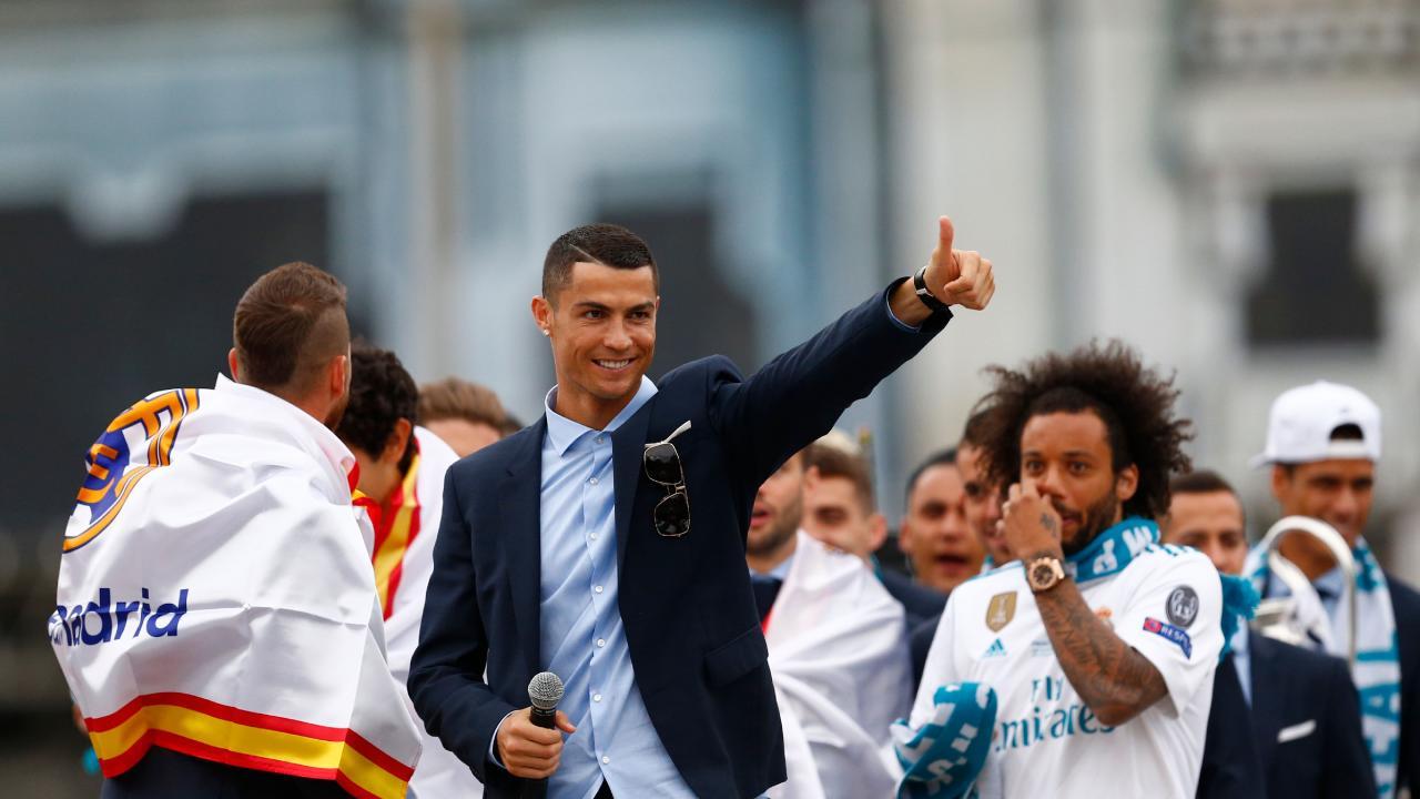 Real Madrid's Portuguese forward Cristiano Ronaldo celebrates with teammates