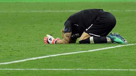 Liverpool's German goalkeeper Loris Karius reacts after the UEFA Champions League final