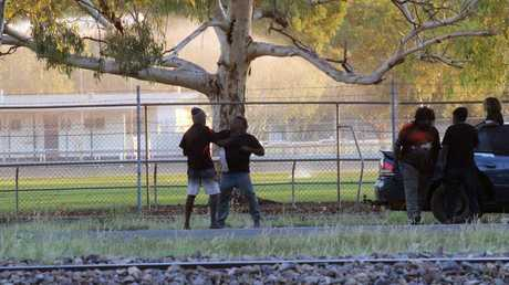 Two men brawl in Alice Springs as a child watched on from the vehicle. Picture: Gary Ramage/News Corp Australia