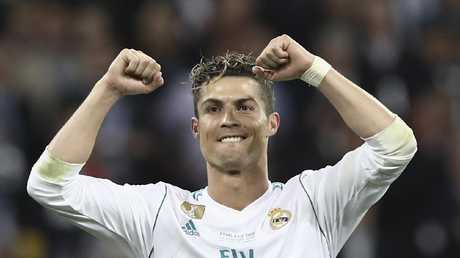 Real Madrid's Portuguese forward Cristiano Ronaldo celebrates after winning the UEFA Champions League final