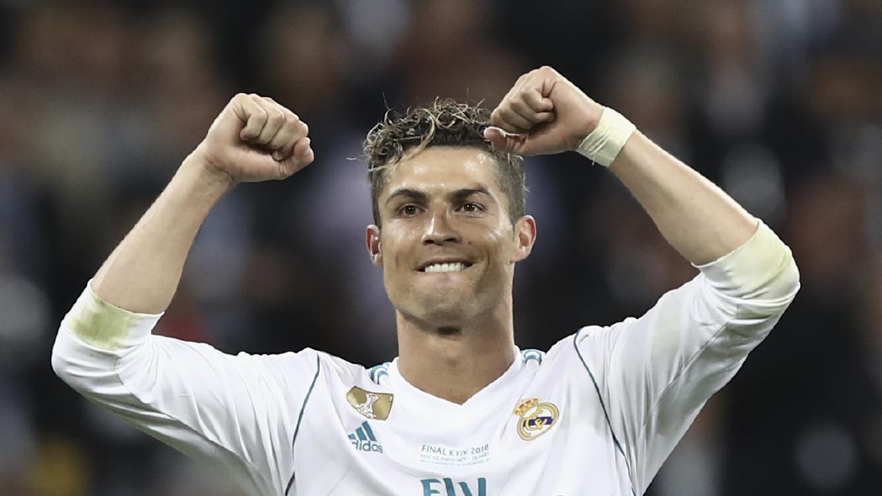 Real Madrid's Portuguese forward Cristiano Ronaldo celebrates after winning the UEFA Champions League final