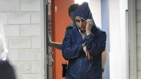 Jade Walker is escorted from Kogarah police station.