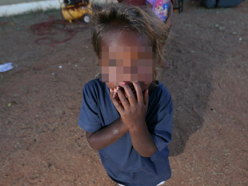 A child playing in a community north of Alice Springs. There is no suggestion this child has been abused. Picture: Gary Ramage/News Corp Australia