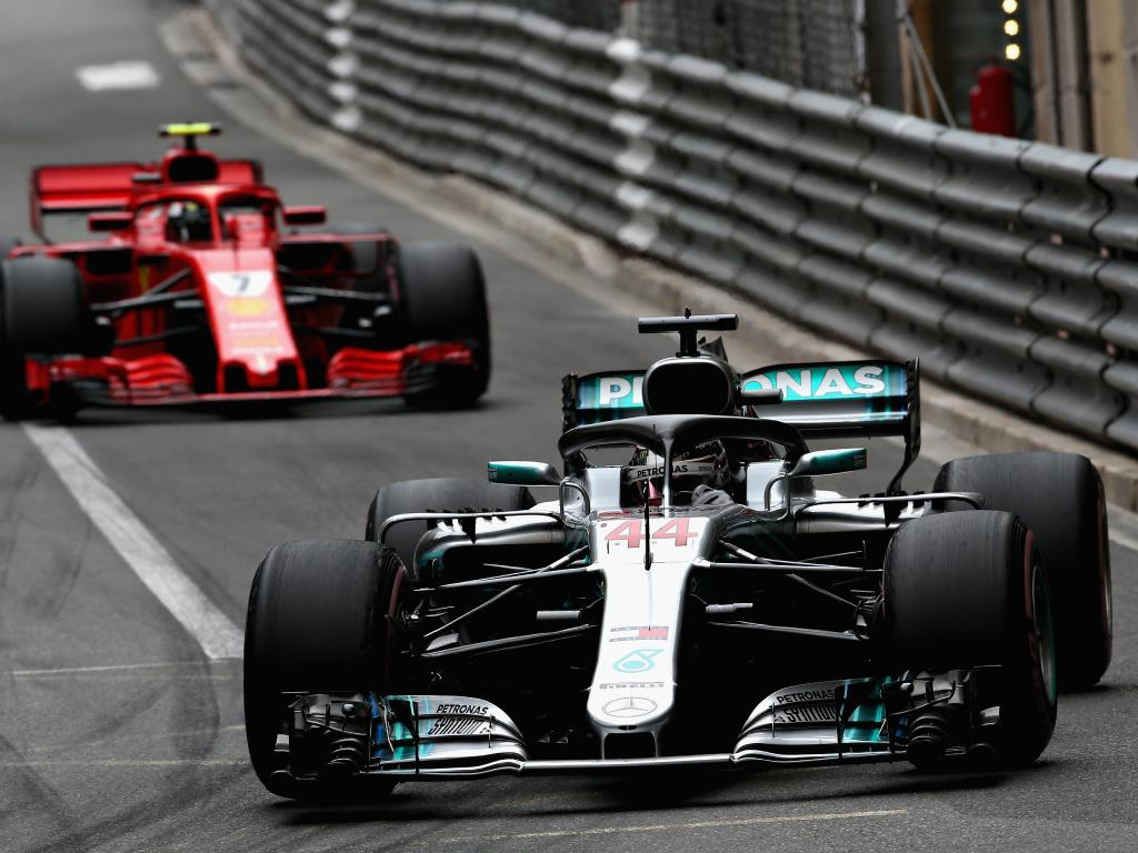 Lewis Hamilton drives in front of Kimi Raikkonen. (Photo by Charles Coates/Getty Images)