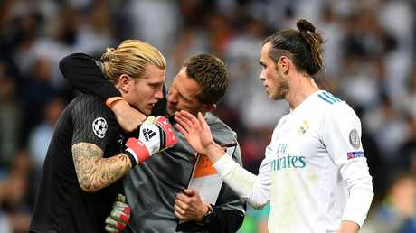 Gareth Bale of Real Madrid speaks with Loris Karius of Liverpool after the UEFA Champions League Final