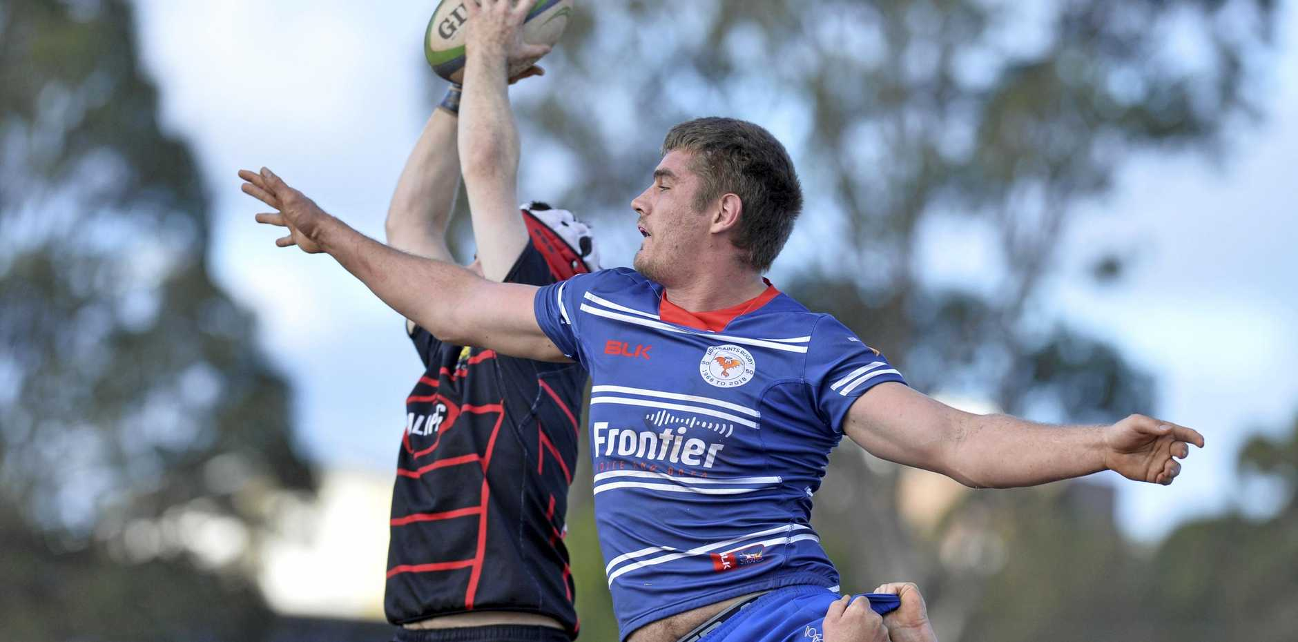 LINE-OUT: Gatton's Oscar Radford wins the ball in the air ahead of USQ's Andre van Staden on Saturday.