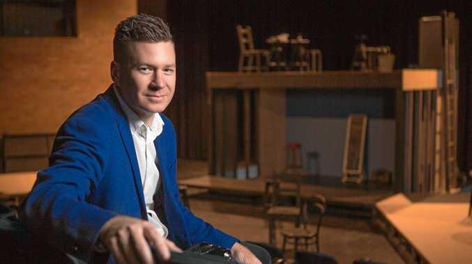 STAGE WORK: Brad Jennings in front of the set for Brisbane Girls Grammar School's Senior Drama Production.