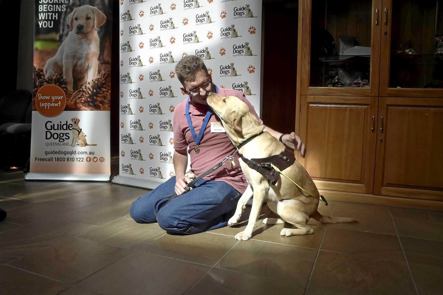 John Gamble and his guide dog, Heidi.