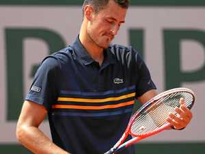 Tomic crashes as his father takes control again