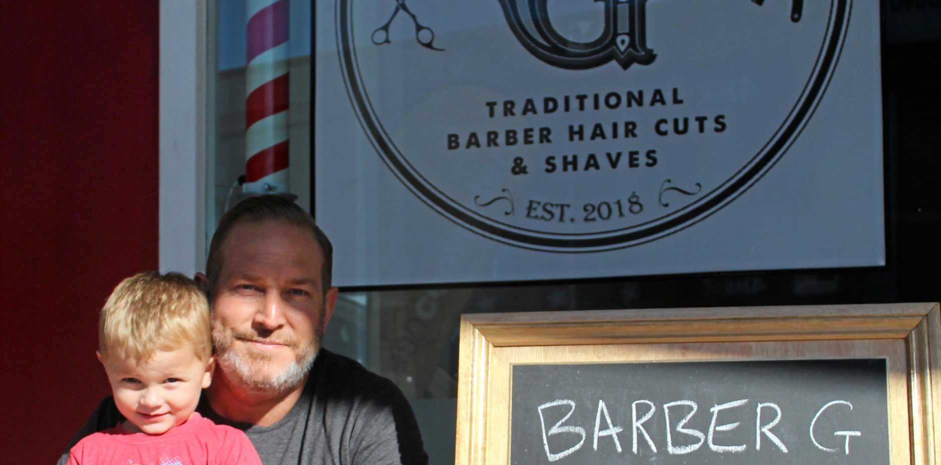 Simon Greavett with his son Bailey, 3, is opening a barber shop on Sydney Street in July