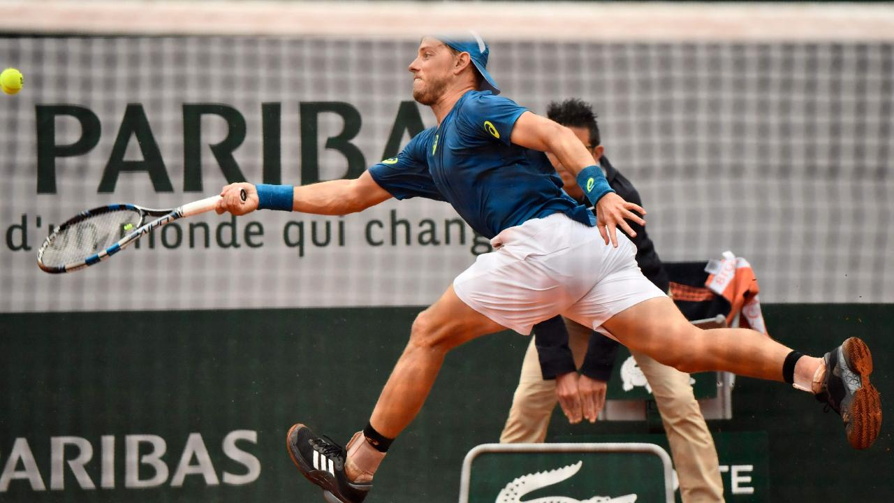 Australia's James Duckworth plays a forehand return to Croatia's Marin Cilic during their men's singles first round match on day three of The Roland Garros 2018 French Open tennis tournament in Paris on May 29, 2018. / AFP PHOTO / CHRISTOPHE SIMON