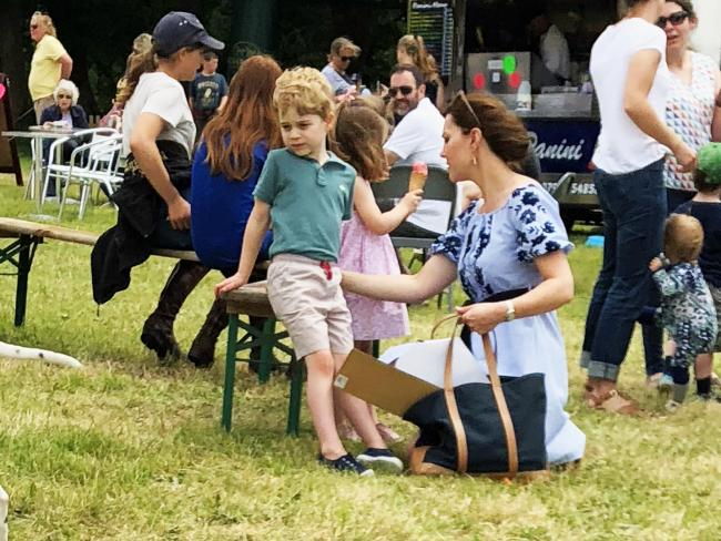 Prince George, Princess Charlotte and their mum, the Duchess of Cambridge, enjoying a day out at the Houghton Horse Trials. Picture: Jack Schmollmann