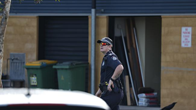 Police at North Lakes State College yesterday. Picture: Annette Dew