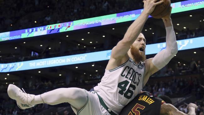Boston Celtics centre Aron Baynes grabs a tough rebound despite nursing a broken nose.