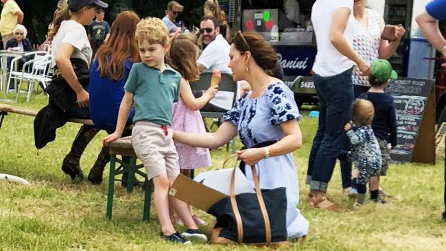 Prince George, Princess Charlotte and Kate Middleton, Duchess of Cambridge at the Houghton Horse Trials in the UK. Picture: Jack Schmollmann