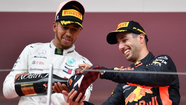 Lewis Hamilton pours Daniel Ricciardo a shoey.