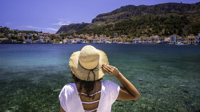 Busted … the woman was caught out via holiday photos on Facebook. Picture: iStock