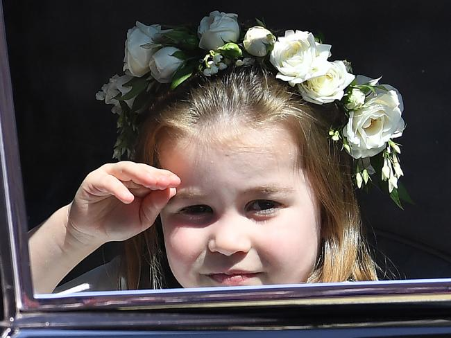 Princess Charlotte had the royal wave down pat at her uncle's wedding.