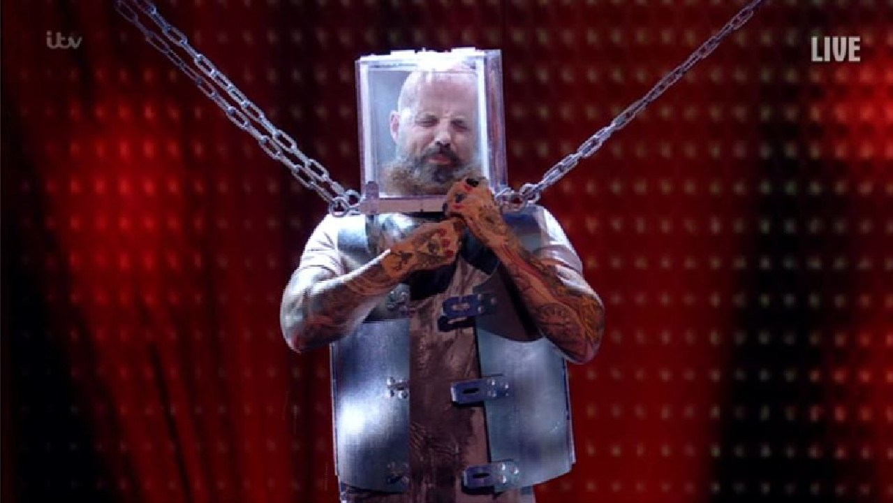 Matt was secured in a solid steel box with padlocks, chains around his body and handcuffs on his wrist. Picture: ITV
