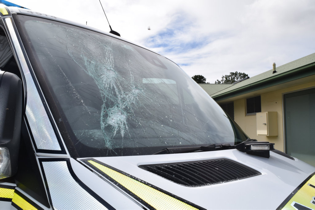 An ambulance was damaged and a paramedic injured after a person smashed the windscreen of the vehicle with a metal pole.