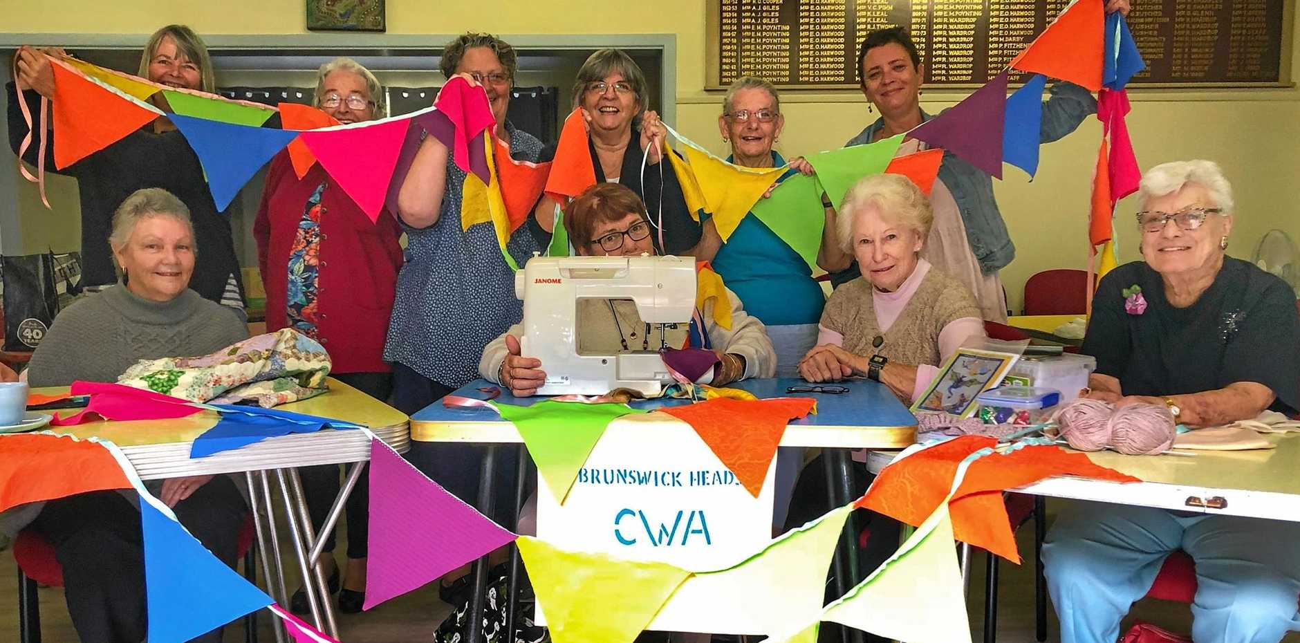 BUSY BEES: Members of the Brunswick Heads CWA have been busy making bunting for this year's Old and Gold Festival.