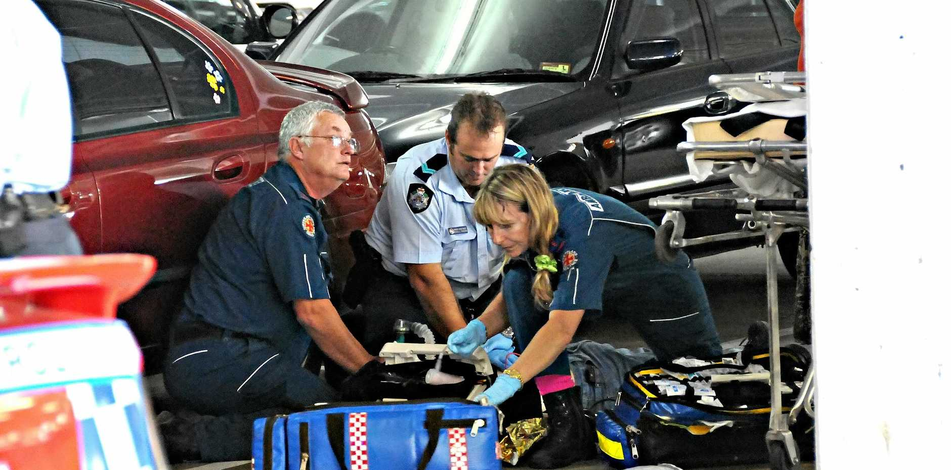 TRAGIC END: Police and paramedics work on the Jaxson Bradey, the victim of a fatal stabbing at Goldfields Plaza in 2009.
