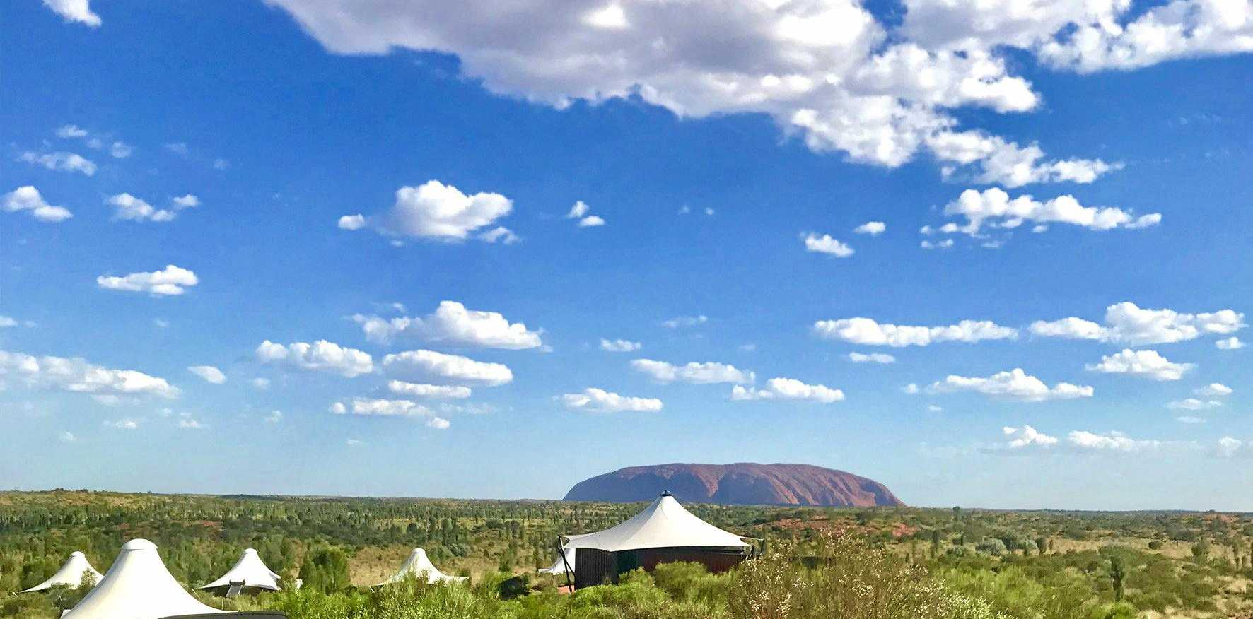 IMPRESSIVE OUTLOOK: The author enjoying the elevated Dune Pavilion plunge pool and sun deck overlooking Uluru.