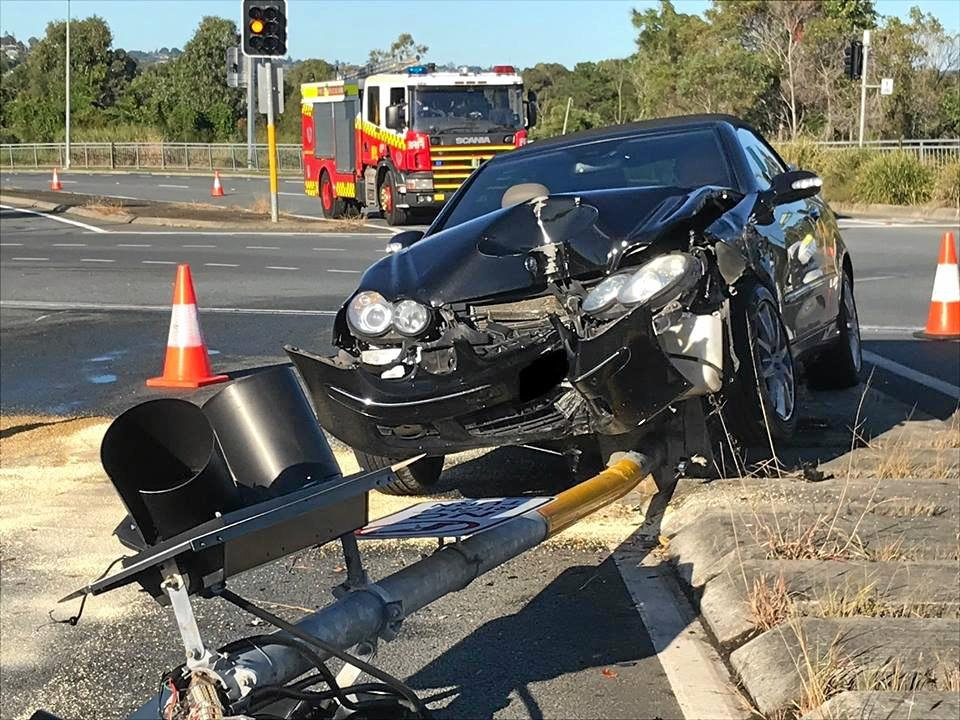 A Mercedes-Benz convertible has been destroyed after a collision with a traffic light this morning.