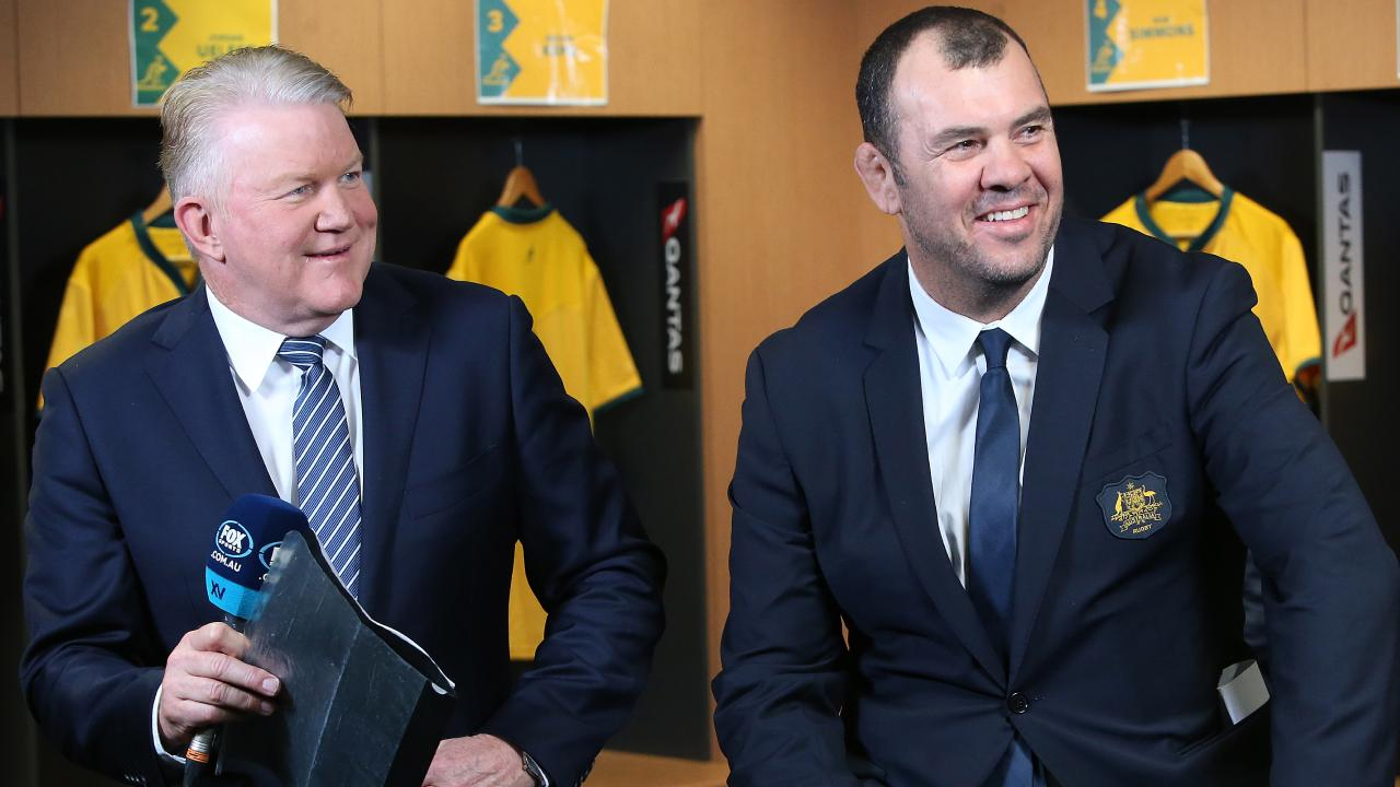 Wallabies coach Michael Cheika (right) announces players with Greg Clark from Fox Sports  at Suncorp Stadium.