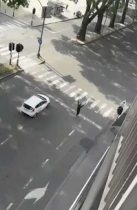 The attacker walks with his hands in the air. Picture: AP