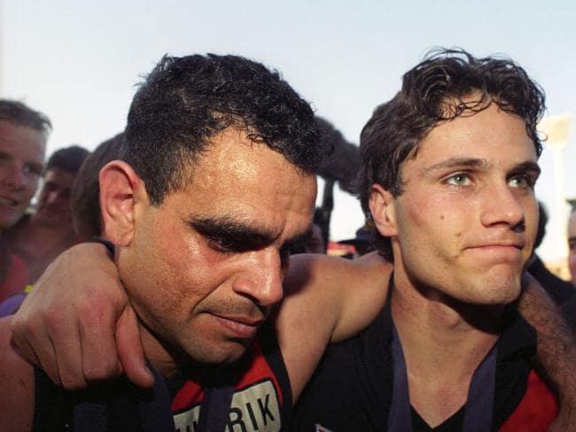 Essendon greats Michael Long and Gavin Wanganeen after their 1993 grand final win.