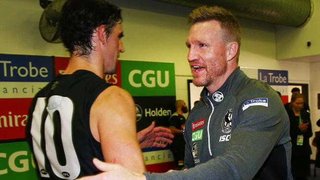 Collingwood coach Nathan Buckley celebrates the win with Scott Pendlebury.