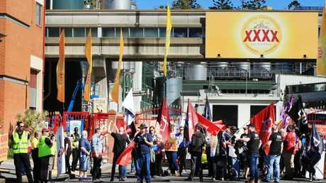 XXXX workers blocked trucks from entering the Milton brewery.