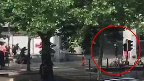 The moment the Belgian terrorist is shot by police.