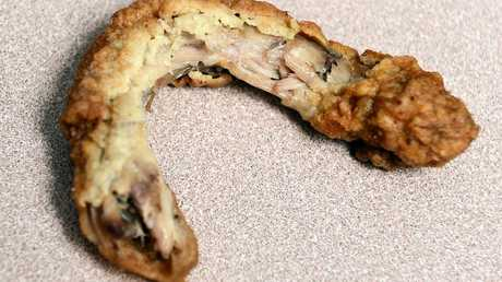 56-year-old Kirwan man Greg Locke found a chicken neck crumbed, fried and coated in 11 secret herbs and spices among his KFC pack.