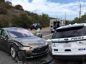 Tesla electric car on autopilot rams police car