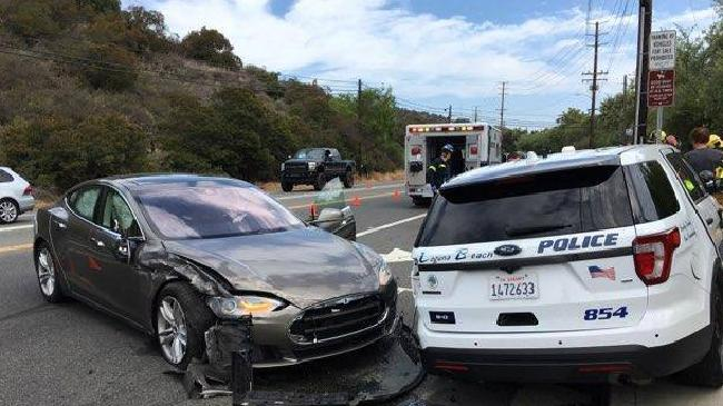 A Tesla car that was in Autopilot mode crashed into a parked police SUV in southern California today. Picture: Laguna Beach Police Dept.