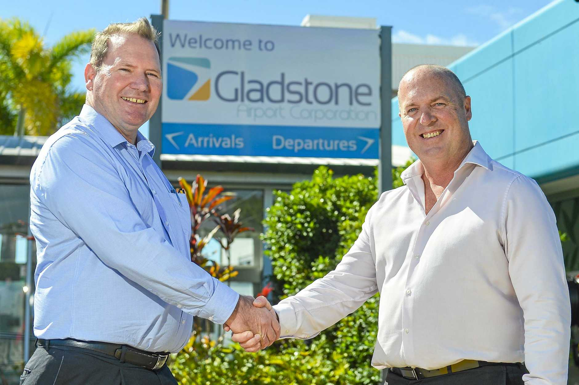 DEPARTURE: Outgoing Gladstone Airport Corporation chief executive officer Peter Friel (right) with incoming CEO Colin Fort.