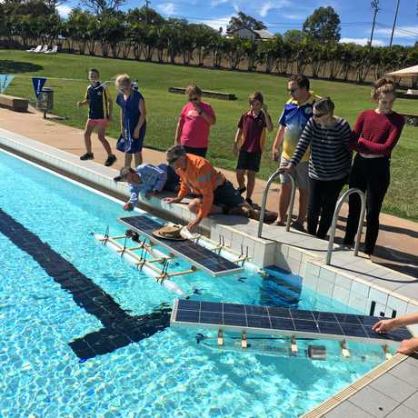 The solar boats go for a test run at the public pool.