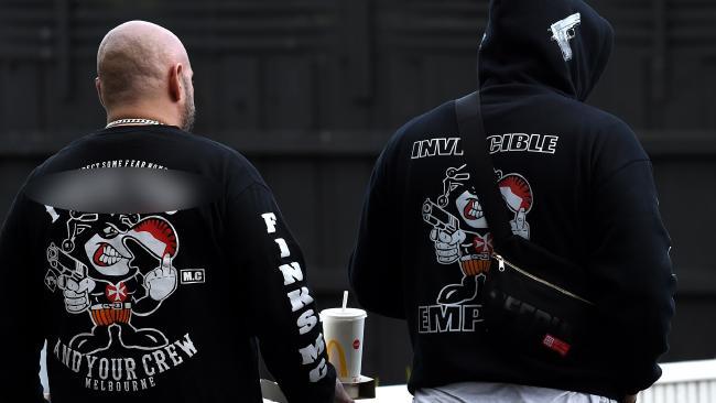 Men wearing Finks insignia bikie jumpers at the scene of the Frankston shooting. Picture: Nicole Garmston