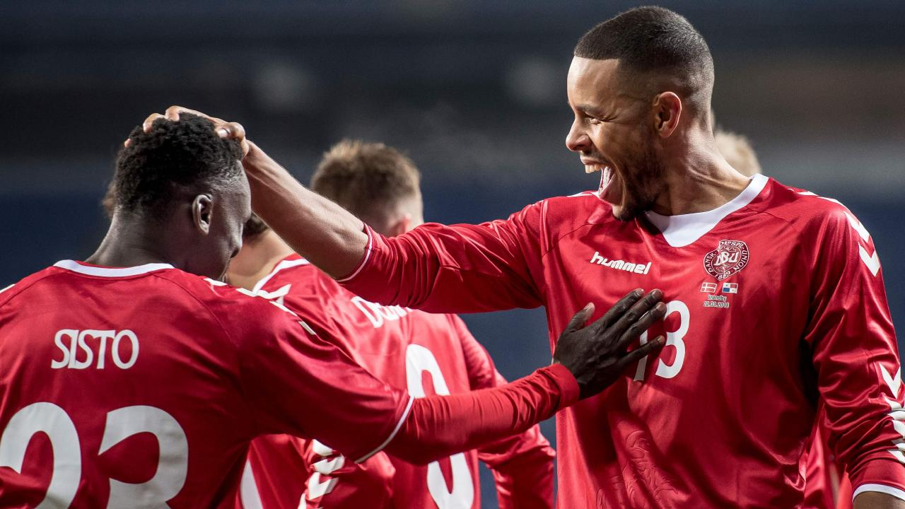 Denmark's Pione Sisto (left) celebrates with teammate Mathias Jorgensen.