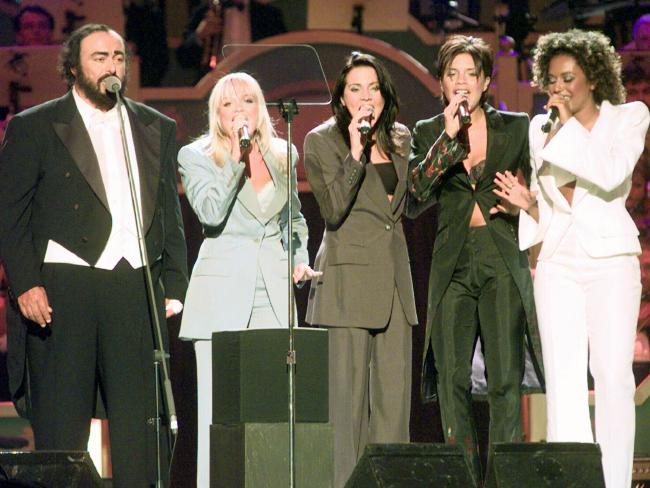 Italian tenor Luciano Pavarotti (L) performs with the Spice Girls just over a week after Geri's departure on June 9, 1998. Pavarotti had attempted to bring Geri back for the performance, but she declined.